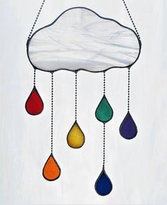 Item #319 This handmade suncatcher features a whimsical puffy cloud with suspended raindrops. The default option for this piece is a wispy white cloud with 6 drops in a blue/green palette with black patina (shown in images 1 and 2). If you would like to alter the default cloud, #StainedGlasses