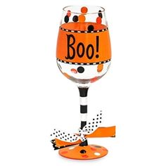This fun Halloween wine glass says Boo! Decorated with black stripes on the stem and polka dots on the bowl. This Halloween wine glass is frighteningly cute. Packaged in a clear acrylic gift box.