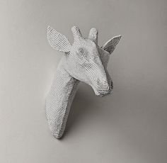 RH baby&child's Papier-Mâché Giraffe Head:Recycled materials transform iconic animal images into eco-friendly sculptures for the walls. Our papier-mâché bust is handcrafted by artisans in Haiti using only recycled paper, recycled steel wire and arrowroot starch glue.
