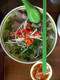 Pho, a tasty dish from Vietnam.  Pho consists of noodles, broth, some small green vegetables (chives, onion, etc.)