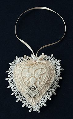 lucky-sixpence-heart-lace.jpg (365×600) The traditional wealth charm of a silver sixpence for the bridal couple that can also be used as an unique wedding favour. The lucky sixpence is in a pouch mounted in a lace trimmed organza heart.  The long ribbon carrying handle makes this lovely keepsake an ideal good luck gift for a small child to present to the bride.