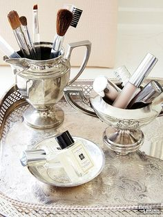 Whether a family heirloom or a tag-sale find picked up for a song, silver coffee and tea sets serve as refined foundations for creating well-stocked makeup stations. Sans lids, sugar holders, cream pitchers, and teapots provide elegant storage units for brushes and beauty supplies./
