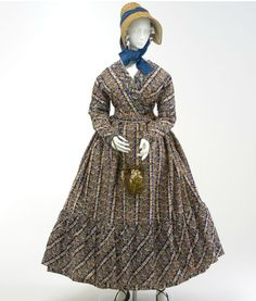 Maternity Dress 1820-1830 Australia | The dress has been made with slits at the side, forming a drop apron at the front to allow for an expanding waistline.