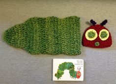 Caterpillar baby gift set with book, Very Hungry Caterpillar baby shower gift set, newborn photo prop, gender neutral. $55.00, via Etsy.