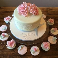Mint and pink birthday cake with cupcakes. Rose cupcakes