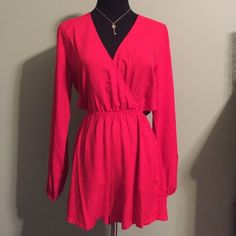 Last one! Red side cut out romper This romper is a sexy side cut out. Each side has a triangle cut out. This piece is wholesale and does not have hang tag. Retail items may or may not include hang tags. Boutique Pants Jumpsuits & Rompers