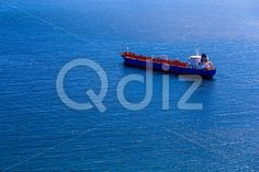 Qdiz Stock Photos | Empty container cargo ship in sea,  #blue #boat #cargo #commerce #commercial #container #delivery #empty #freight #industrial #industry #international #logistics #marine #moving #nautical #ocean #offshore #sea #ship #shipping #tanker #transport #transportation #vessel #water #waterline