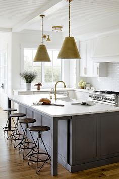 Dark grey island Dark grey kitchen island with honed white marble industrial backless counterstools brass cone pendant light and ceiling with tongue and groove paneling #kitchen #kitchenisland #darkgreykitchenisland #greyisland