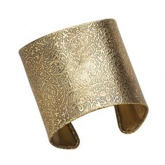 This cuff bracelet can define an entire outfit: the intricate, scrolling, floral pattern balances out the bold statement of brass.