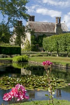 The Lily Pool in the Rose Garden with the house beyond at Bateman's, East Sussex