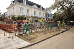 Mardi Gras parade ladders lined up on St. Charles Avenue, where families spend Mardi Gras!