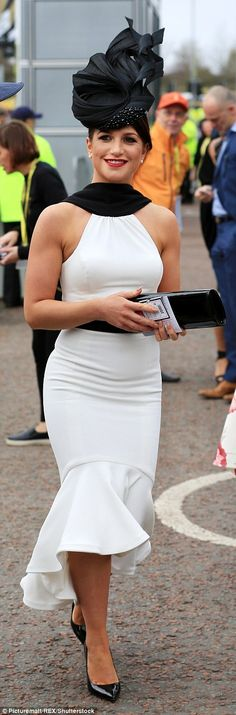 interesting neck detail  // A woman looked stunning in a black and white dress and striking hat