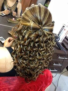 WOW!!!! Amazing bow made out of hair anddddd curls!!!!