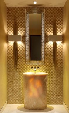 Opulent look for a bathroom without spending too much- you would need good play of lights and nice metallic tiles