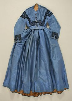 The museum designates this as 1860, but the two-piece coat sleeve seems to indicate a later date, perhaps 1863-65.