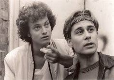 """A young, curly Gary Sinise in a Steppenwolf production. A black-and-white shot of """"City on the Make,"""" a play based on the writings of Nelson Algren,"""