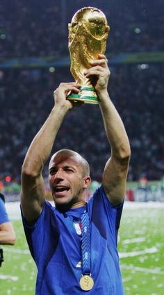 Alessandro Del Piero of Italy lifts the World Cup trophy aloft following his team's victory in a penalty shootout at the end of the FIFA World Cup...