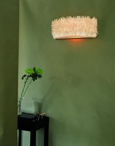 coco wall light from ochre  strips of coconut shell