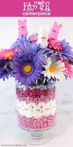 DIY Easter centerpiece idea with daisies and candies.