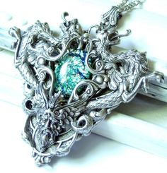 A custom order, where the Dread Lord Silver was converted to have a green stone and a loop at the bottom. See the original Dread Lord Silver or buy the . The Dread Lord Silver Custom Fantasy Jewelry, Green Stone, Ring Necklace, Dreads, Jewelery, Eagle, Lord, Hair Accessories, Deviantart