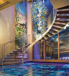 Suspended glass chandelier, elegant glass railed staircases, massive windows and glass water floors... you have just entered heaven for glass-lovers!