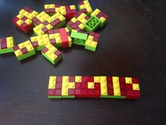 Homemade Braille tiles for Mackenzie made from LEGO.  Colour coded so non Braille readers have quick reference between vowels and consonants.  Also will be labelled on bottom to give a reference for what is down.  Magnets can be added to the back so they can be used on the fridge or on a cookie tray.
