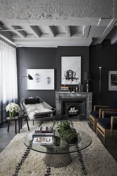 dark walls, moody  charcoal grey living room shot by romain ricard for elle decoration