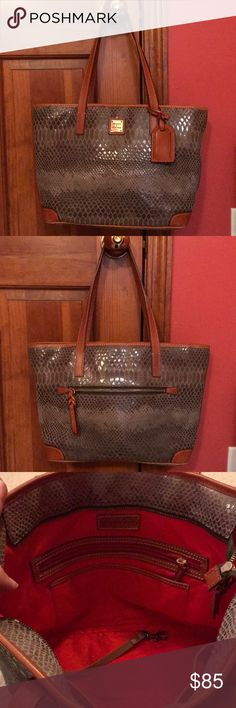 Authentic Dooney & Bourke Faux Crocodile Bag Gorgeous faux crocodile leather bag. Authentic. Perfect condition. Gold metal accents and brown leather. Bag looks shiny green/silver in different lights. Measurements shown. Accepting reasonable offers.  Check out my authentic dust bags! Dooney & Bourke Bags Shoulder Bags