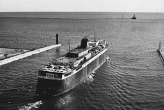 The Chesapeake & Ohio carferry Badger steams out of Milwaukee with a load of freight cars for Ludington, Mich., sometime in the mid-1970s. The last Great Lakes carferry to be built, the 60-year-old, coal-fired Badger is also the last in service, sailing from Ludington to Manitowoc, Wis., between May and October with loads of cars, trucks, and passengers, but no freight cars
