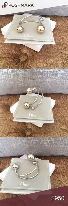 Christian Dior Mise En Dior gold silver bracelet Gorgeous Authentic Christian Dior Mise en Dior Collection Two-tone gold silver Cuff Bracelet. Excellent condition. This bracelet is for the woman who doesn't pile on the jewels, and shies away from loud colors and prints. The modern design will make it look as if the pearls are almost floating on your wrist Dior Jewelry Bracelets