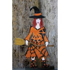 This Art Doll was created by Susan Whittmore using the Mixed Media Art doll and it so looks like this witch is looking right at you!