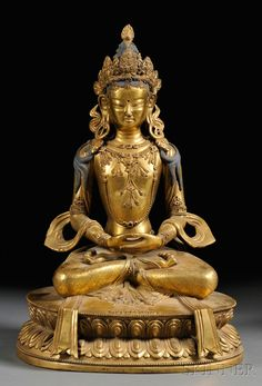"""Gilt-bronze Figure, Sino-Tibetan, depicting Buddha seated in meditation in dhyanasana pose on a double-lotus pedestal, hair painted with blue pigment, the flanking ears with earring, both hands in dhyani mudra, carved in relief with """"Da Qing Qian Long Nian Jing Zao,"""" at the base, ht. 14 1/2 in"""