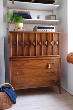 Immaculate Kent Coffey dresser: three bottom drawers, and one shelf in the upper cabinet.