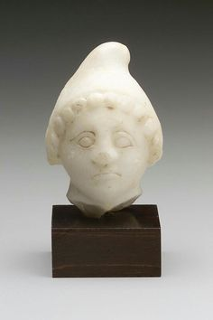 Marble head of Men or Attis (eastern divinities). Roman Provincial. Imperial Period, c. A.D. 100–250 | Museum of Fine Arts, Boston