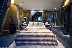 Everything from the plush bed linen down to the books on the bedside table are included in...
