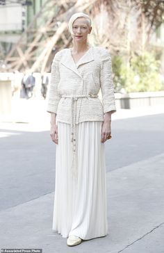 Actress Tilda Swinton poses for photographers upon arrival at the Chanel Haute Couture Fal...