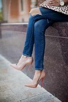 Christian Louboutin pumps, blue skinny jeans and leopard clutch