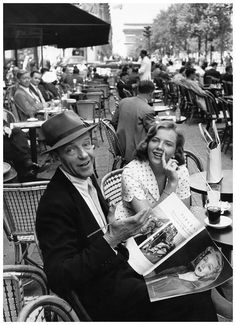 Fred Astaire sitting with his daughter, Ava, sitting at Fouquets on the Champs-Élysées, Paris, 1961.