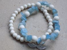 Sky and Snow-Double strand stretchy Aquamarine chips with 8mm and 6mm natural whitewood beads. Sterling Silver Angel Wings charm. #skyandsnow  https://www.etsy.com/listing/217068184/sky-and-snow-double-strand-stretchy?ref=shop_home_active_22
