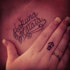 chest tattoo, finger tattoo.
