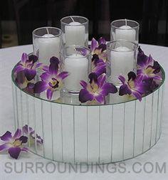 Votives & orchids on riser candle centerpiece