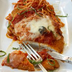 Chicken Parmesan  In a large saute pan heat a 2-count of oil (about 2 tablespoons) over medium heat. When the oil is hot and hazy, add the onion, garlic, and bay leaves; cook and stir for 5 minutes until fragrant and soft. Hand tear half of the basil leaves. Add the olives and hand-torn basil.  Carefully add the tomatoes; cook and stir about 15 minutes until the liquid is cooked down and the sauce is thick. Season with sugar, salt,  and pepper. Lower the heat, cover, and keep warm.