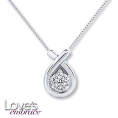 Brilliant round diamonds cluster within a high-polish sterling silver swirl in this stylish necklace for her, from Love's Embrace®. The pendant has a total diamond weight of 1/10 carat and sways from an 18-inch box chain that has a 2-inch extender and is secured with a spring ring clasp. Love's Embrace.® You will always be surrounded by the strength of my love.™ Diamond Total Carat Weight may range from .085 - .11 carats.