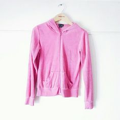 $10 !!!! Wet Seal Pink Zip up Hoodie PLEASE READ! This hoodie has a few stains!! The stains are shown in the pictures. I honestly don't ever recall wearing this because not my style so I don't even know how it has so many stains. Really soft and nice feel. 80% cotton 20% polyester Wet Seal Tops Sweatshirts & Hoodies