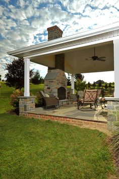 like this type of roof design and with outdoor fireplace