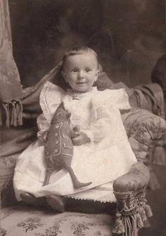 baby with a brownie cloth doll