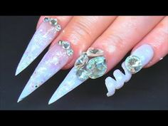 These are the same theme but opposite to my 'Icy wedding spiral nails'! I sculpted the stiletto nails and used a smaller straw for the spiral. I do hope u li...