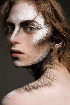 "Not exactly a creature, but I suppose you could imagine this to be fantasy makeup. ""Wind lines"" - these people, when exposed to the wind, gain temporary straight or curved lines on their skin where wind has ran over it. If they run against the wind, the lines are darker and last longer..."