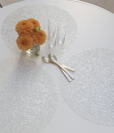 """Chilewich Filigree Pressed Vinyl Round Placemat 15"""" Silver/White by Chilewich. $10.00. Material: Vinyl. Round 15"""". This finely embossed ornamental design is created with a one-of-a-kind mold and is spot printed with metallic foil to suggest a weathered look of a delicate, old textile."""