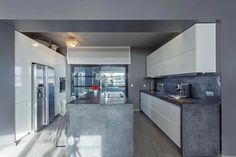 Introducing a fantastic grey loft, situated in Athens, Greece, designed by Studio LILA architect + designer.